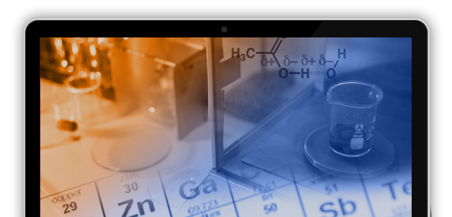 periodic tables and beakers on a laptop